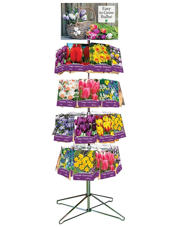 """Metal spinner rack with retail packages of fall bulbs hanging on pegs. POP sign attached to the top of the display that says """"Easy to Grow Bulbs!"""" with a basket of flowers."""